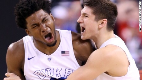 Justise Winslow #12 of the Duke Blue Devils reacts with Grayson Allen #3 after a play late in the second half against the Wisconsin Badgers during the NCAA Men's Final Four National Championship at Lucas Oil Stadium on April 6, 2015 in Indianapolis, Indiana.