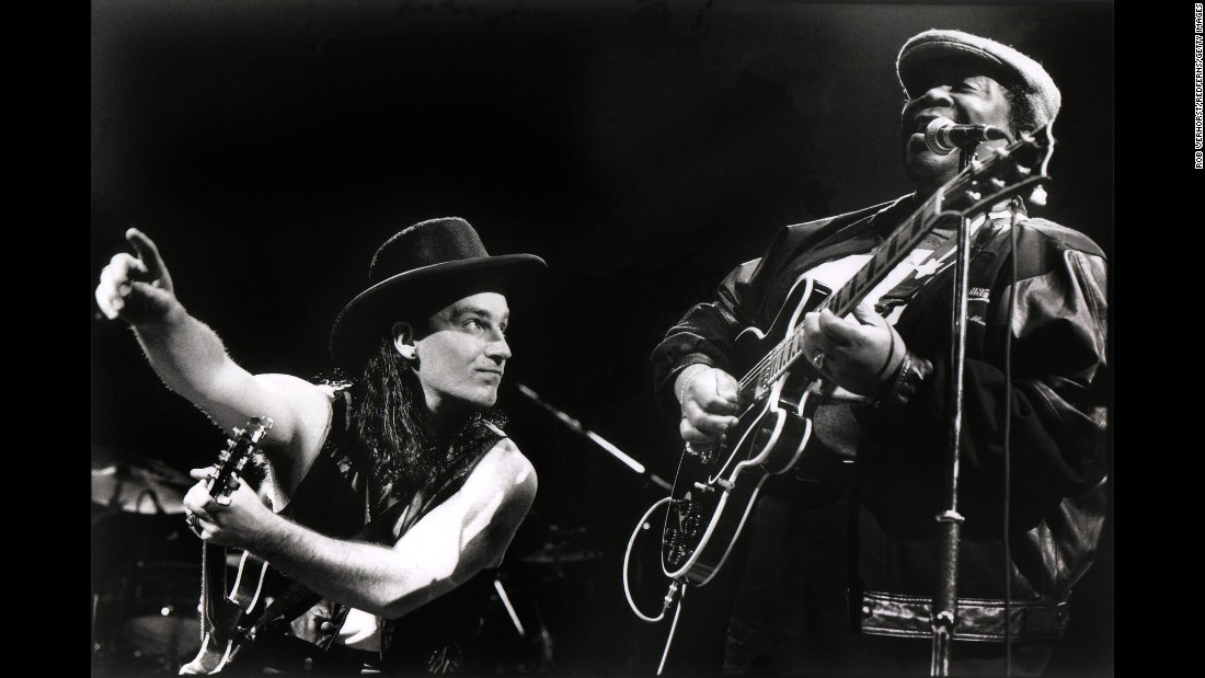"King and Bono of U2 perform in Rotterdam, Netherlands, in 1990. King recorded the song ""When Love Comes to Town"" with the band."