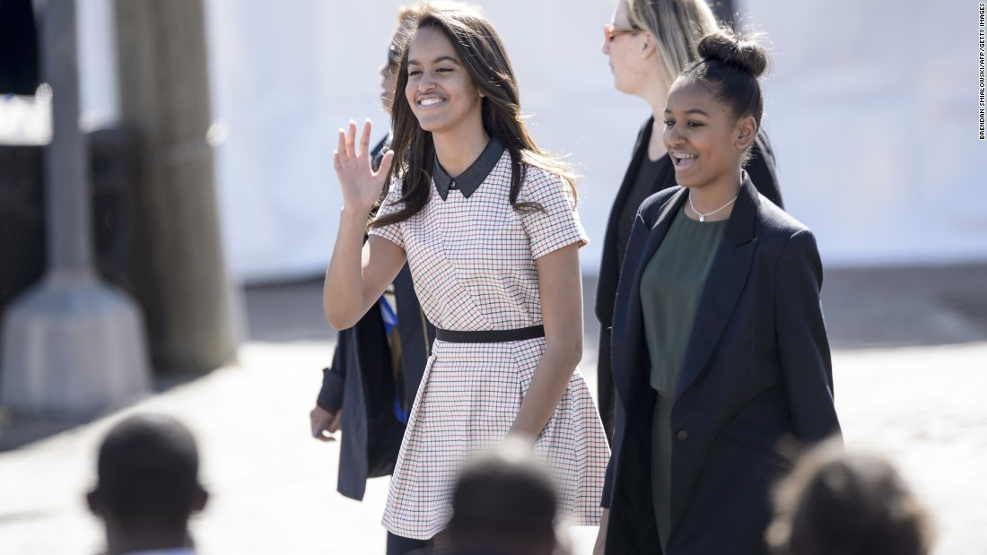 Malia and Sasha Obama arrive before their father at the Edmund Pettus Bridge on March 7, 2015, in Selma, Alabama. The Obamas were in Alabama to commemorate the 50th anniversary of Bloody Sunday, when voting rights marchers attempting to walk to the Alabama capitol clashed with police.