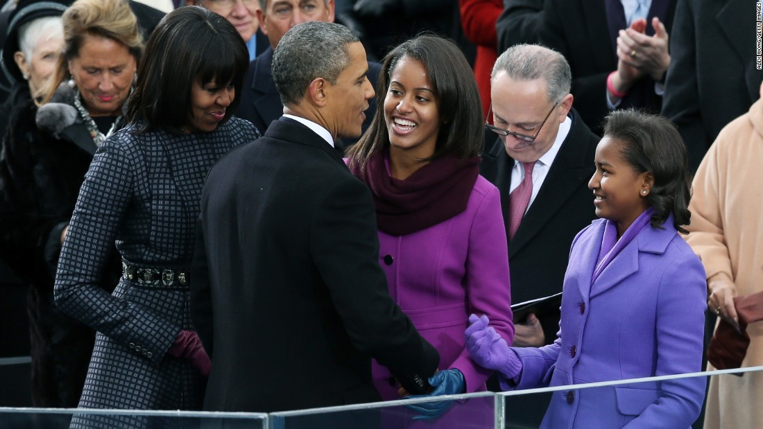 President Obama greets his wife and daughters after being sworn in for his second term on the West Front of the U.S. Capitol on January 21, 2013.