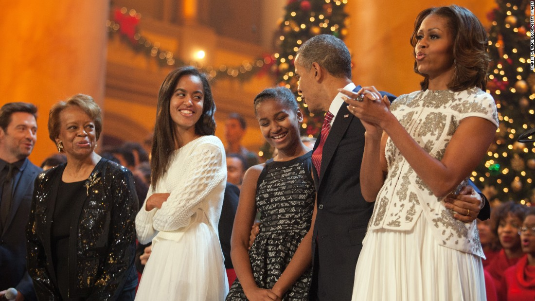 "The first family sings during the finale of TNT's ""Christmas in Washington"" on December 15, 2013.  Also shown are Mrs. Obama's mother, Marian Robinson, and the program's host, actor Hugh Jackman."