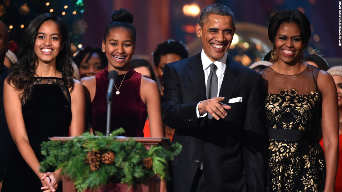 "Malia, Sasha, President Obama and the first lady speak onstage during the taping of TNT's ""Christmas in Washington"" on December 14, 2014."