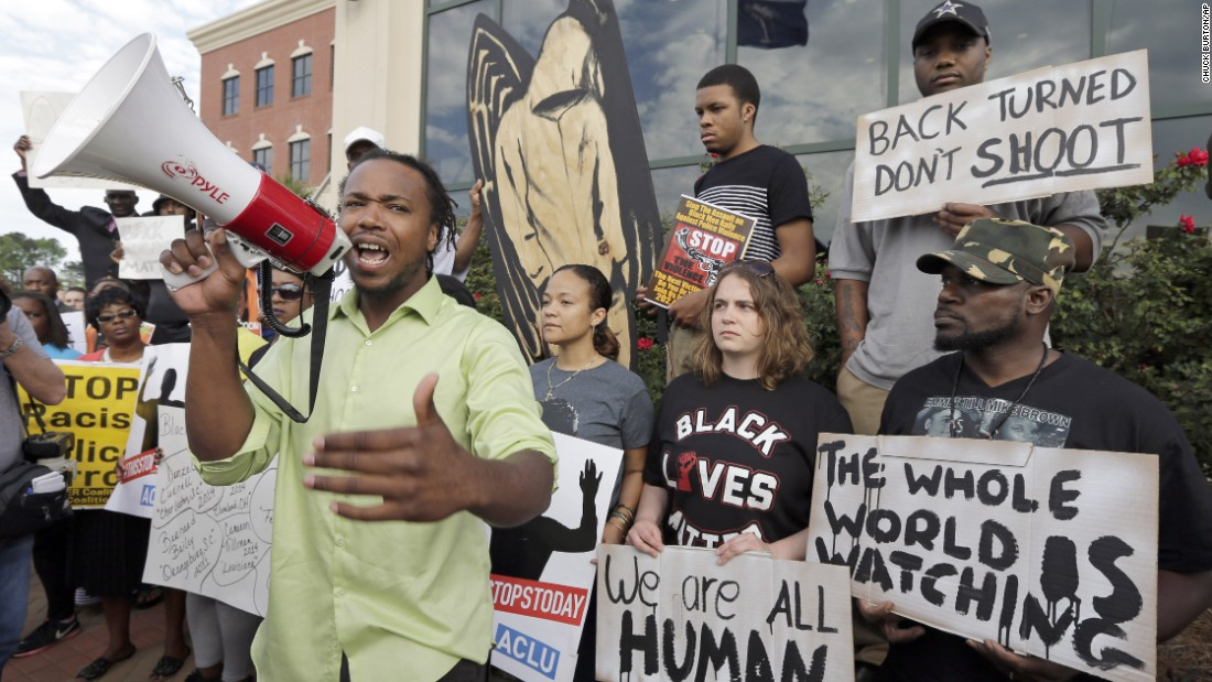 People protest Scott's shooting as they rally outside North Charleston's City Hall on April 8.