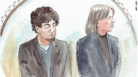 Dzhokhar Tsarnaev stands beside his lawyer, Judy Clarke, as the verdict is read in court.