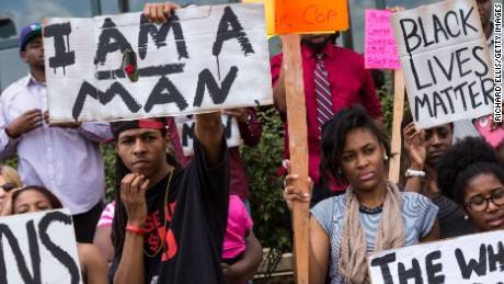 NORTH CHARLESTON, SC - APRIL 08:  People participate in a rally to protest the death of Walter Scott, who was killed by police in a shooting, outside City Hall on April 8, 2015 in North Charleston, South Carolina. Video captured by a bystander showed officer Michael Slager shooting Scott as he ran away. Officer Slager has been charged with murder as a result of the incident.  (Photo by Richard Ellis/Getty Images)