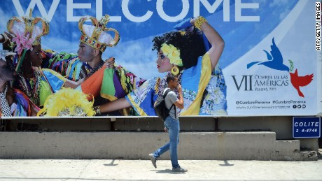 A man passes by a board near the Atlapa Convention center days before the start of the VII Summit of the Americas which starts next April 10 and 11, in Panama City, on April 8, 2015. AFP PHOTO / RAUL ARBOLEDARAUL ARBOLEDA/AFP/Getty Images