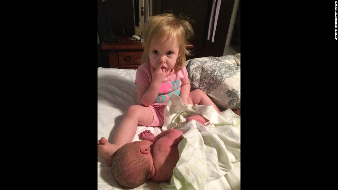 """""""My son had been born at home at 4 a.m. while Julia was sleeping in the front bedroom. My husband brought her in when she woke up and she immediately kissed her baby brother. ... Then she couldn't stop staring in amazement at him."""" -- <a href=""""http://ireport.cnn.com/docs/DOC-1231634"""">Jennifer Prescott</a>, Tustin, California"""