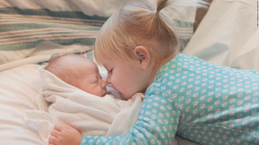 """CNN invited readers last year to share photos of children with their new siblings. Here, Cecelia, 2, meets baby Sullivan. """"Cece is very possessive of her little brother. 'He's mine' or 'my brother' or 'my Sully' are her favorite things to say to strangers when we are out together in public."""" -- <a href=""""http://ireport.cnn.com/docs/DOC-1231966"""">Cary Chadwick</a>, Higganum, Connecticut"""