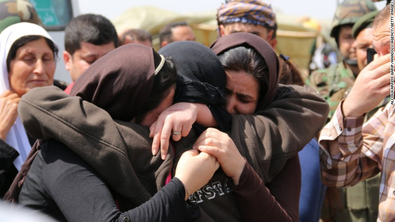 """Yazidis embrace after being released by ISIS south of Kirkuk, Iraq, on Wednesday, April 8.<a href=""""http://www.cnn.com/2015/04/08/world/isis-yazidis-released/""""> ISIS released more than 200 Yazidis</a>, a minority group whose members were killed, captured and displaced when the Islamist terror organization overtook their towns in northern Iraq last summer, officials said."""