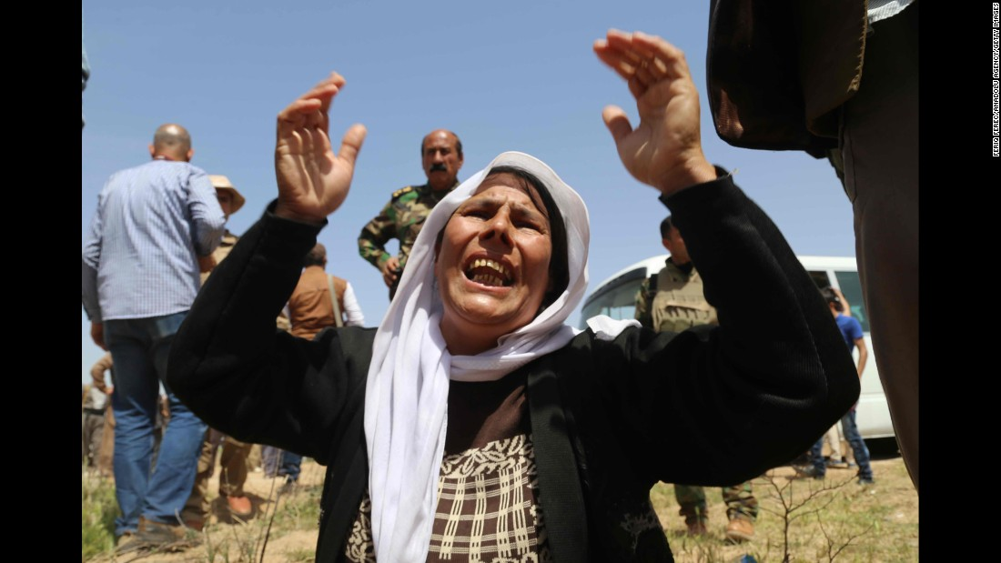 A Yazidi woman mourns for the death of her husband and children by ISIS after being released south of Kirkuk on April 8. ISIS is known for killing dozens of people at a time and carrying out public executions, crucifixions and other acts.