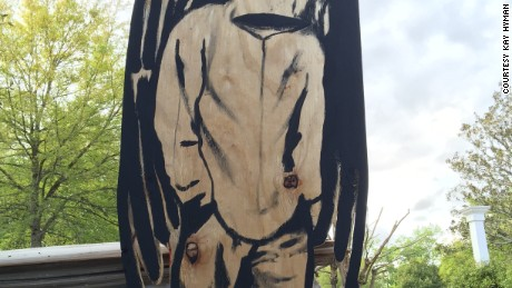 Hyman, who grew up in a rough neighborhood in North Charleston, couldn't sleep after he heard about the shooting. At 3 a.m. NEED DATE, he rifled through his trash, found the perfect piece of wood and created this piece of art.