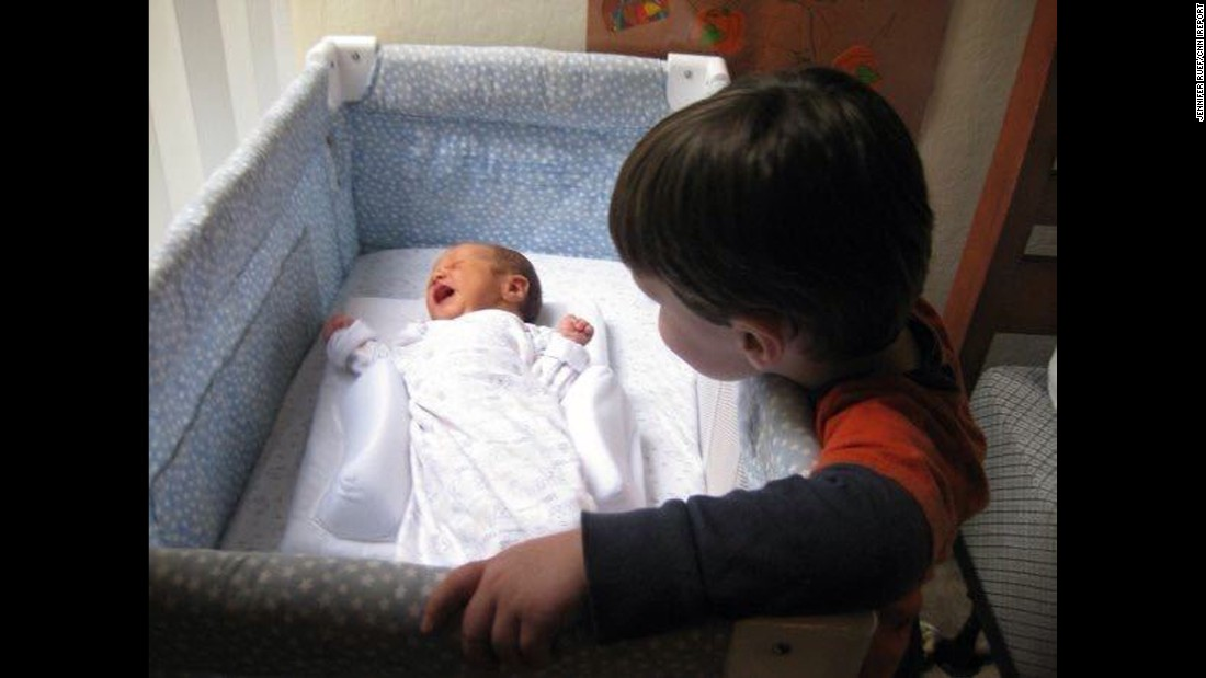 """""""Edison was so excited to meet his baby brother. Every picture we own shows him touching Donovan in some sweet way. Two years later, we lost our dear Edison. We know he continues to watch over Baby D, his brovey."""" -- <a href=""""http://ireport.cnn.com/docs/DOC-1232291"""">Jennifer Ruef</a>, Chapel Hill, North Carolina"""
