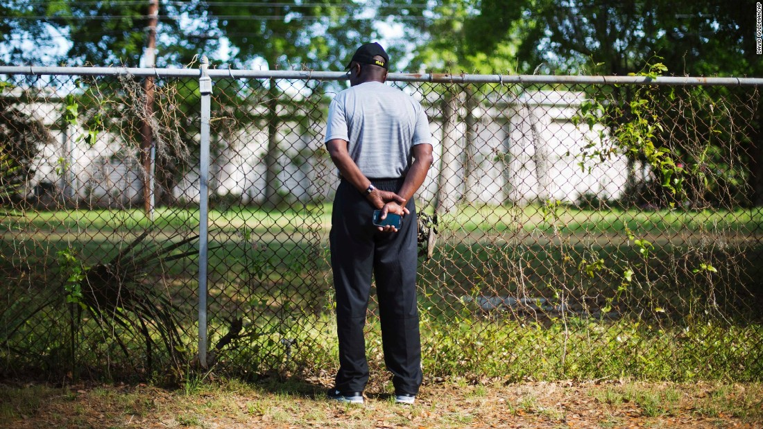 "Joe Gilliard looks over a fence Thursday, April 9, at the spot where Walter Scott was shot and killed by a police officer April 4 in North Charleston, South Carolina. The officer, <a href=""http://www.cnn.com/2015/04/08/us/south-carolina-michael-slager/index.html"" target=""_blank"">Michael Slager</a>, has been charged with murder in the fatal shooting of<a href=""http://www.cnn.com/2015/04/08/us/south-carolina-who-was-walter-scott/index.html"" target=""_blank""> Scott</a>, an unarmed 50-year-old. Video captured by a bystander showed Slager shooting Scott as he ran away."