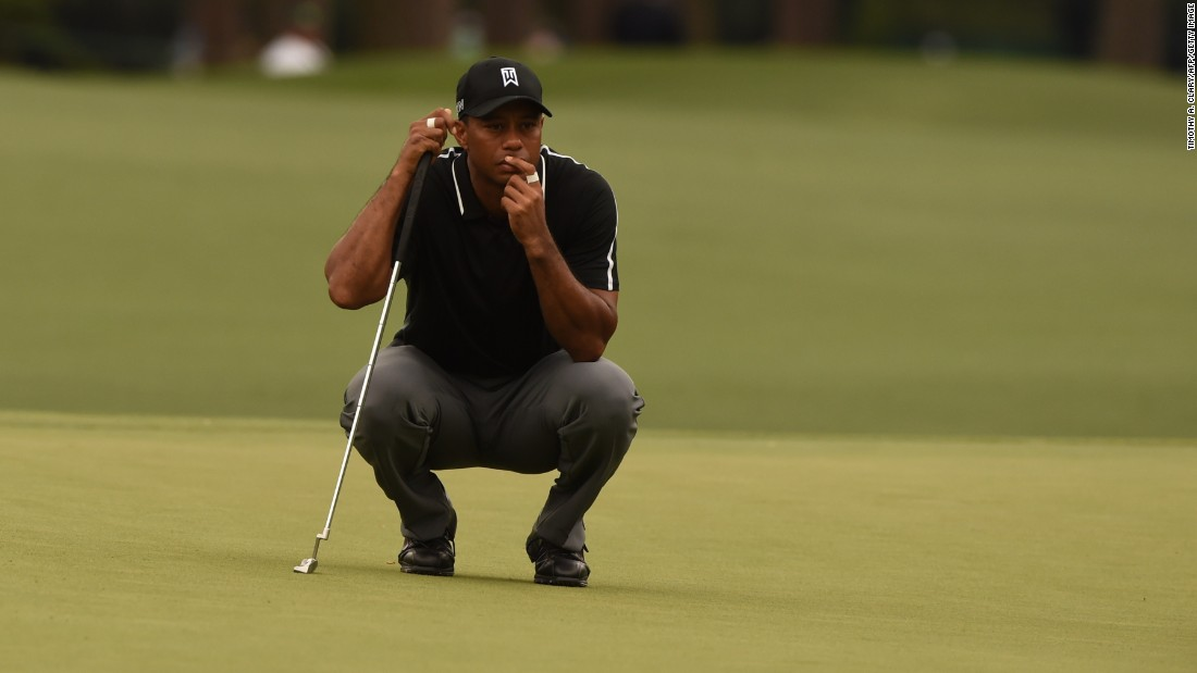 Tiger Woods lines a putt during Round 2 of the 79th Masters Golf Tournament on Friday. Woods' short game has been highly scrutinized during his comeback.