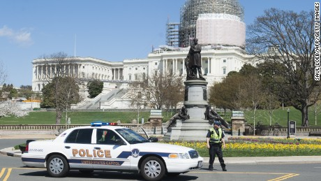 """US Capitol Police respond to reports of a shooting at the US Capitol in Washington, DC, April 11, 2015. Shots were fired near the steps of the US Capitol Saturday leading to a lockdown of the building, police said, adding that the threat had been """"neutralized."""" US Capitol Police told AFP that the shooting took place on the western side of the building and that officers are investigating a suspicious package on a nearby terrace. Police did not provide details on the shooting, but said a """"threat"""" had been """"neutralized."""" AFP PHOTO / SAUL LOEB        (Photo credit should read SAUL LOEB/AFP/Getty Images)"""