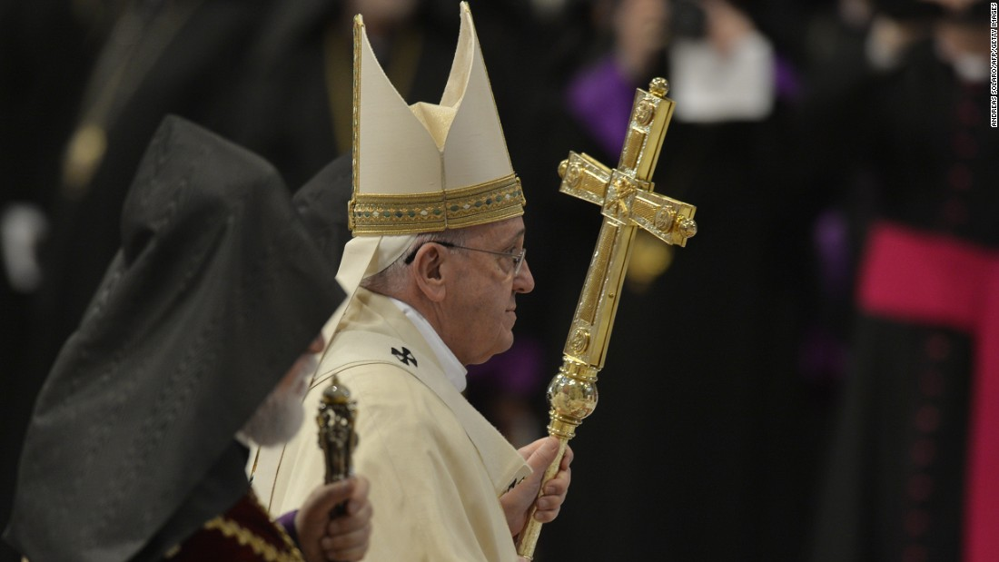 Pope Francis leaves at the end of an Armenian rite Mass on Sunday, April 12.