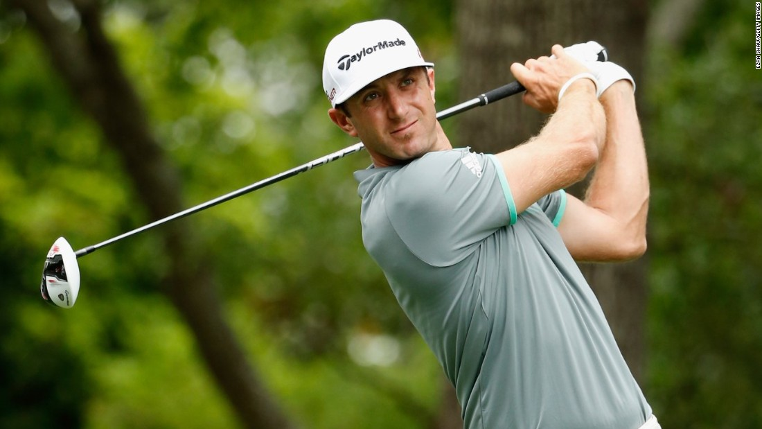 American Dustin Johnson made his move up the leaderboard with three successive birdies from the sixth hole, to be outright fourth after his front nine -- eight shots behind Spieth at that stage.