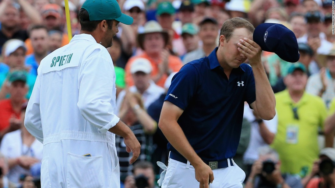 "Masters champion Jordan Spieth savors the moment with his caddy Michael Greller after clinching his first major title by four strokes from Phil Mickelson and Justin Rose. <a href=""http://www.pga.com/masters/scoring/leaderboard"" target=""_blank"">(See leaderboard)</a>"