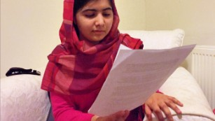 Malala Yousafzai, reading her open letter to kidnapped Nigerian schoolgirls to mark the anniversary of their abudction.