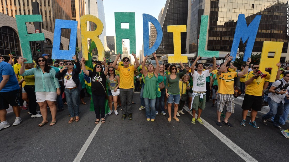"Demonstrators hold letters reading ""Dilma out"" during a protest against the government of president Dilma Rousseff."