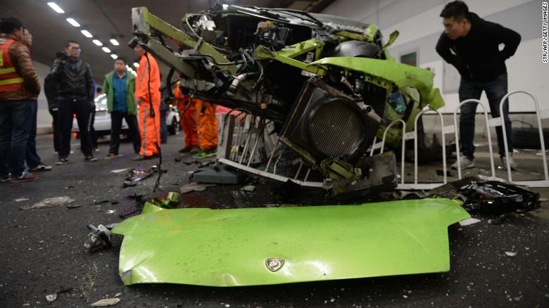 Police investigate the wreckage of the totaled Lamborghini.