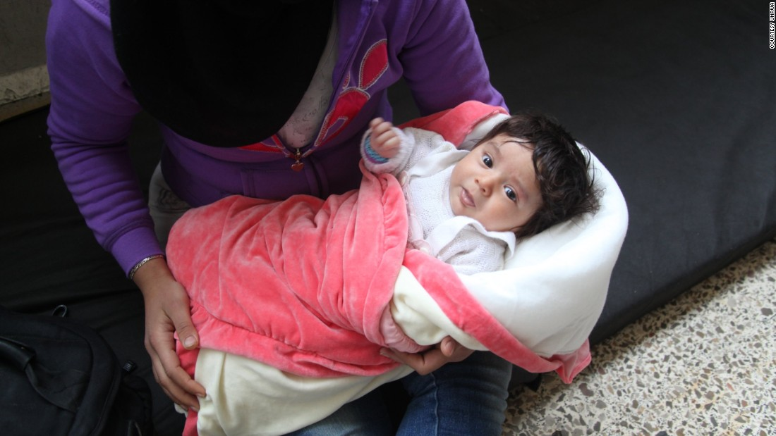 As many as 5,000 people have tried to flee their homes since ISIS stormed Yarmouk in early April. Some, like this woman and child, made it to a government school in Tadamoun.