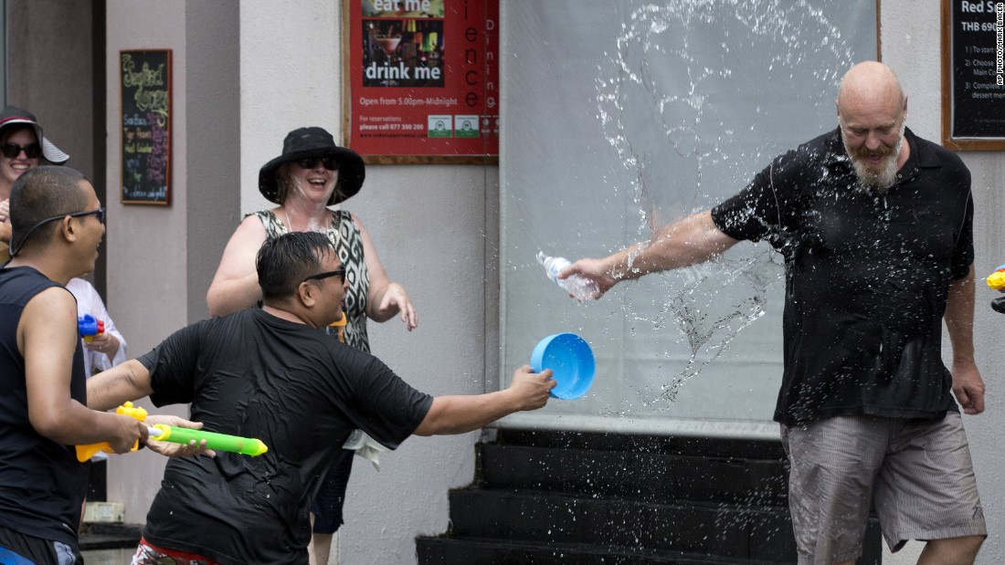 A tourist is showered in water by locals during the Songkran festival. The merrymaking doesn't only happen in Thailand. Countries across Southeast Asia, including Myanmar, Cambodia and Laos also celebrate the New Year water festival in mid-April.
