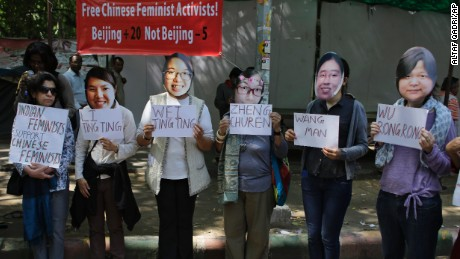 Indian women's rights activists wearing masks of five women's rights activists formally detained in China after Women's Day crackdown, hold placards with their names, to express their solidarity and demand their immediate release, in New Delhi, India, Wednesday, March 18, 2015.