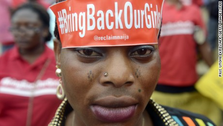 A woman with a sticker on her head bearing the #BringBackOurGirls slogan takes part in a march calling for the release of the more than 200 abducted Chibok school girls in Lagos on May 29, 2014.