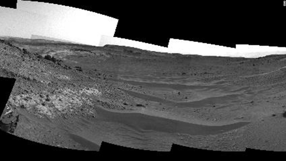 "This April 10 view from the navigation camera on Curiosity shows the terrain ahead of the rover as it makes its way west through a valley called ""Artist's Drive."""