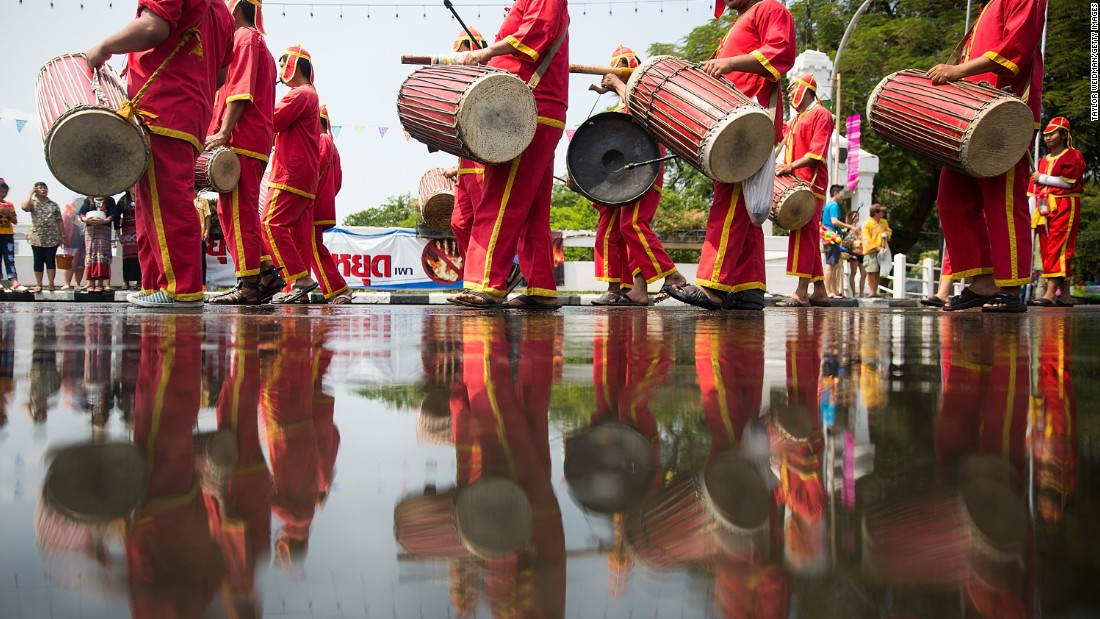 Songkran isn't just about splashing. Cultural activities such as parades and concerts are also held throughout the country to celebrate the Thai New Year. Here, Thai performers take part in a Songkran parade in Chiang Mai, Thailand.