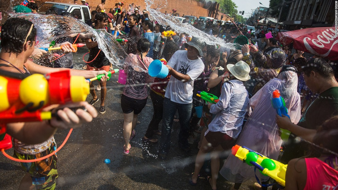 Thai locals and foreigners take part in a city-wide water fight on April 13, 2015 in Chiang Mai. Chiang Mai, in northern Thailand, has a reputation for holding the wildest Songkran festivities.