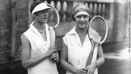 Tennis fashion: 29th April 1926: The perfect tennis costume for the coming season, worn by two players, includes a pique frock, roll stockings, eye shade and light shoes. (Photo by H. F. Davis/Topical Press Agency/Getty Images)
