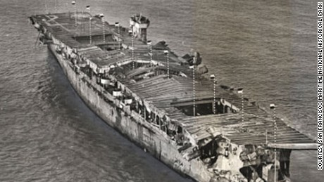 Aerial view of ex-USS Independence at anchor in San Francisco Bay, California, January 1951. There is visible damage from the atomic bomb tests at Bikini Atoll