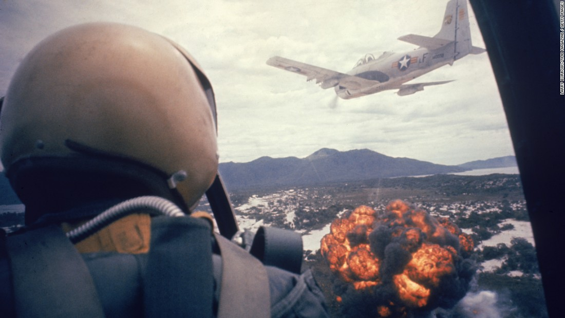 American planes drop napalm on Viet Cong positions in 1962. Hoping to stop the spread of communism in Southeast Asia, the U.S. also sent aid and military advisers to help the South Vietnamese government. The number of U.S. military advisers in Vietnam grew from 900 in 1960 to 11,000 in 1962.