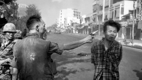** EDS NOTE: GRAPHIC CONTENT ** South Vietnamese General Nguyen Ngoc Loan, chief of the National Police, fires his pistol into the head of suspected Viet Cong officer Nguyen Van Lem (also known as Bay Lop) on a Saigon street, Feb. 1, 1968, early in the Tet Offensive.