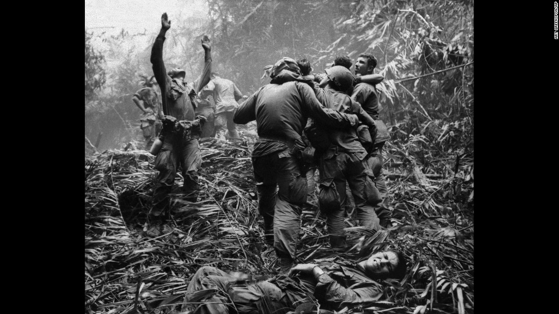 A U.S. Army first sergeant guides a medevac helicopter through the jungle to pick up casualties suffered near Hue in April 1968.