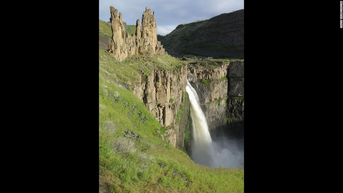 """WASHINGTON: """"The Palouse is a largely agricultural region in western Idaho and eastern Washington. Created by cataclysmic flooding at the end of the last ice age, the 198-foot-falls and 'channeled scablands' at Palouse Falls State Park in Washington state appear as a dramatic surprise in a little visited part of the United States."""" - CNN's Chuck Thompson."""