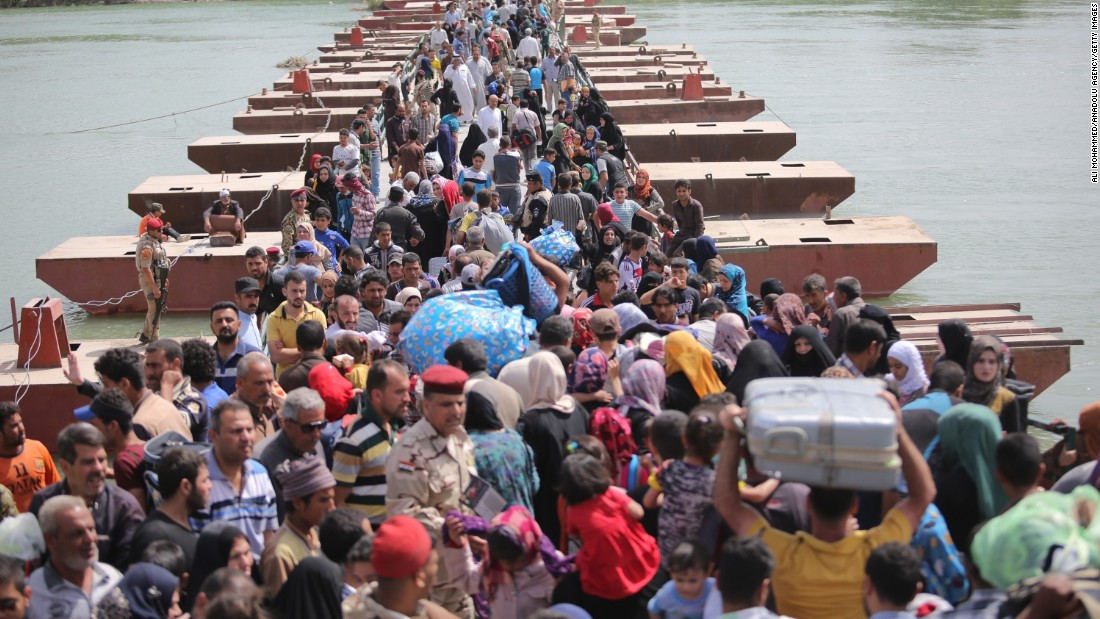 Thousands of Iraqis cross a bridge over the Euphrates River to  Baghdad, as they flee Ramadi, Iraq, on Friday, April 17. The city of Ramadi has been embroiled in clashes with ISIS militants.