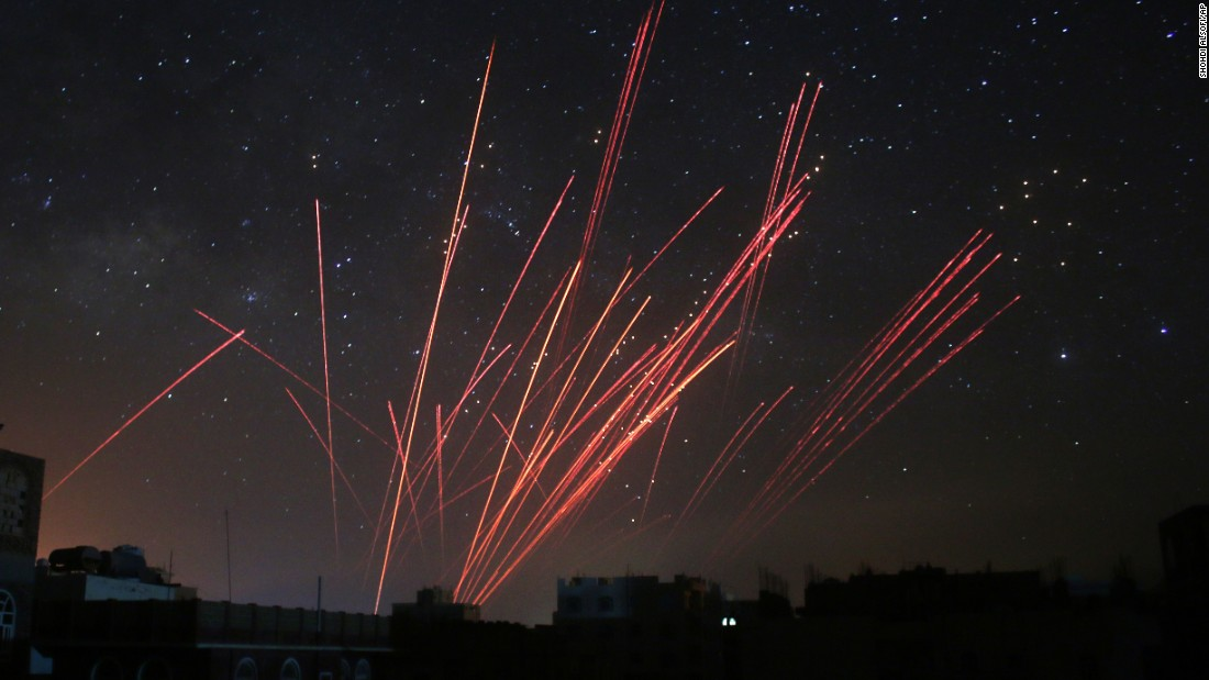 The sky over Sanaa, Yemen, is illuminated by anti-aircraft fire during a Saudi-led airstrike on Friday, April 17. The coalition's warplanes have been carrying out strikes against Houthi rebels since President Abdu Rabu Mansour Hadi fled the country in late March.