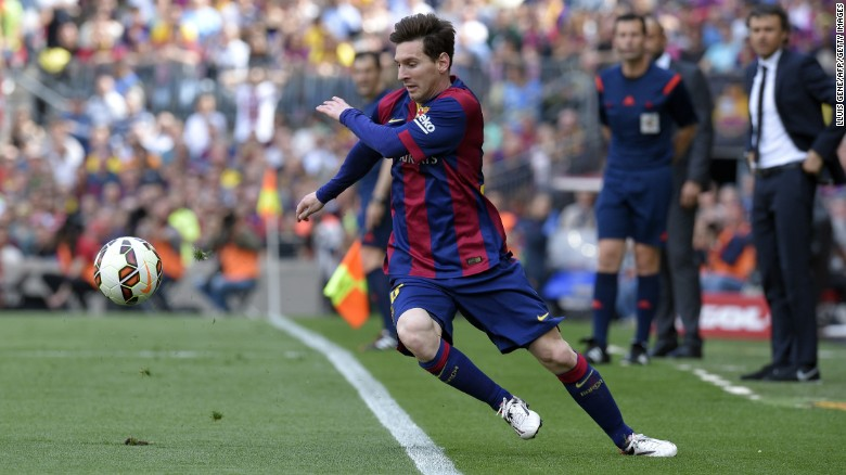 Lionel Messi dances around the Nou Camp touchline as Barcelona face Valencia.
