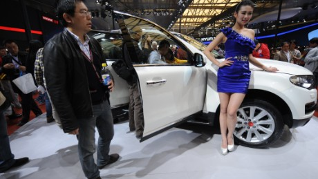 A visitor takes a look at a Haval SUV, a Chinese brand made by Great Wall Auto, on the opening day of the Shanghai auto show on April 21, 2013.