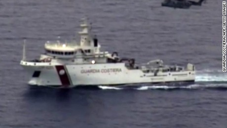 "In this video grab released by the Italian Coast Guards (Guardia Costiera) on April 19, 2015 an helicopter and a ship take part in a rescue operation off the coast of Sicily following a shipwreck last night. Rescuers at the scene of a Mediterranean shipwreck feared to have claimed 700 lives are searching for survivors amongst corpses floating in the water, Malta's Prime Minister Joseph Muscat said. Italy's coastguard said 28 people were known so far to have survived the overnight capsize of a packed fishing boat that was attempting to smuggle hundreds of migrants from Libya to Italy. The coastguard said 24 bodies had been recovered so far. AFP PHOTO / HO = RESTRICTED TO EDITORIAL USE - MANDATORY CREDIT ""AFP PHOTO / GUARDIA COSTIERA"" - NO MARKETING NO ADVERTISING CAMPAIGNS - DISTRIBUTED AS A SERVICE T"