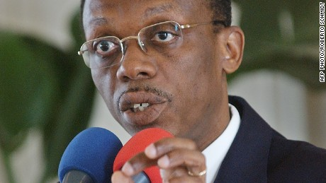 Haitian President Jean Bertrand Aristide addresses a press conference at the presidential palace in Port-Au-Prince February 24, 2004.
