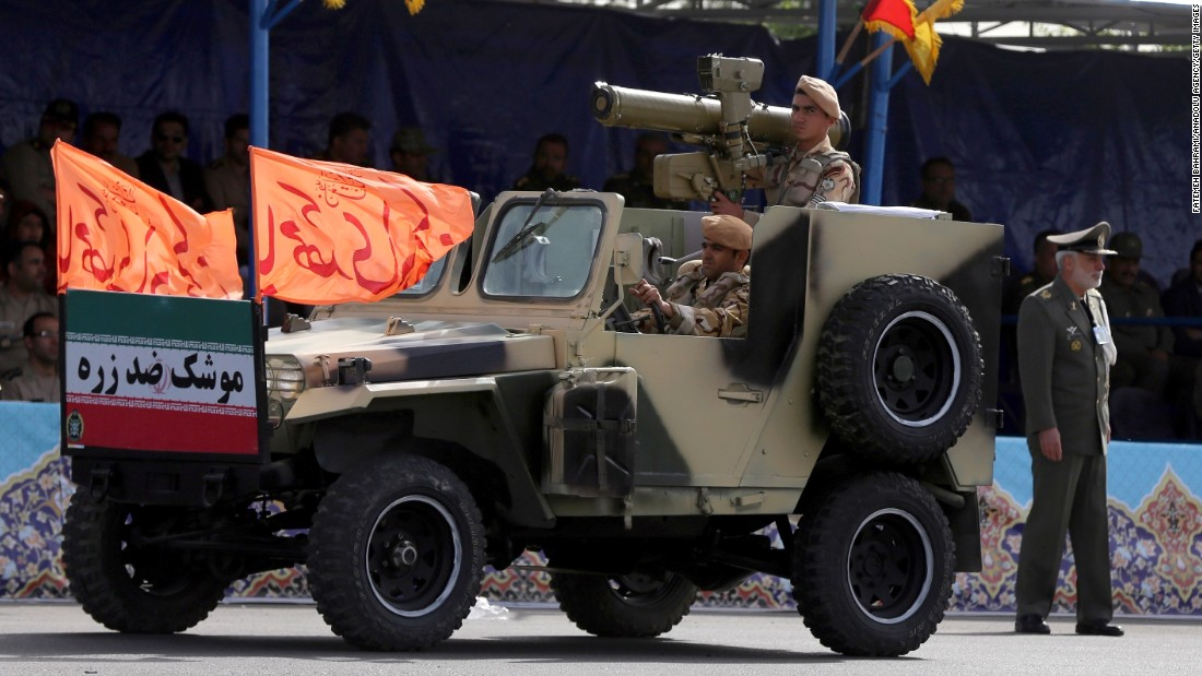Soldiers drive a military vehicle through the parade.