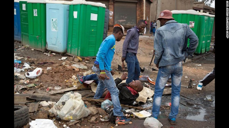 """Oatway's images landed on the front page of South Africa's Sunday Times under the headline, """"Kill thy neighbor: Alex attack brings home SA's shame."""" Seven people have been killed in the latest round of xenophobic violence against poorer immigrants, many from South Africa's neighbors."""