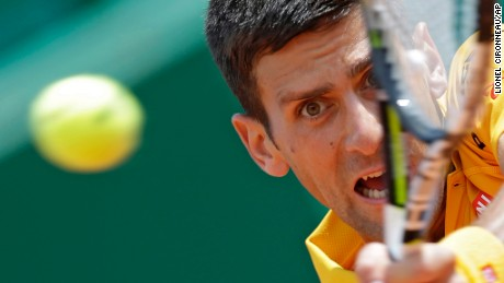 Novak Djokovic of Serbia plays a return to Marin Cilic of  Croatia during their quarterfinal match of the Monte Carlo Tennis Masters tournament in Monaco, Friday, April 17 2015.