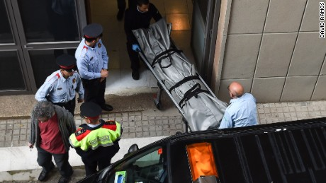BARCELONA, SPAIN - APRIL 20: Judicial staff members take out the body of a teacher allegedly killed by a student armed with a crossbow at the Instituto Joan Foster on April 20, 2015 in Barcelona, Spain. A 13-year-old student reportedly armed with a crossbow has allegedly killed a teacher and injured at least four students this morning at Instituto Joan Foster. (Photo by David Ramos/Getty Images) *** BESTPIX ***