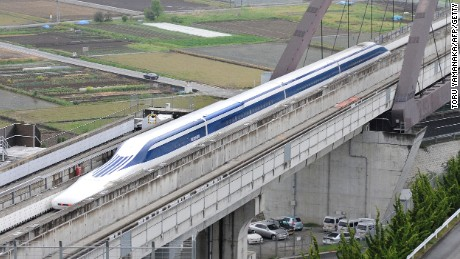 File photo: A Japanese maglev (magnetic levitation) train speeds during a test run on the experimental track in Tsuru, 100km west of Tokyo, on May 11, 2010.
