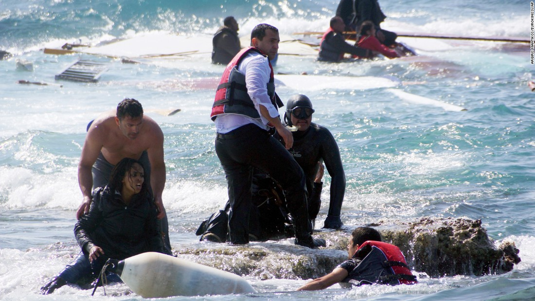 Migrants are rescued from the Aegean Sea, off the coast of the Greek island of Rhodes, on Monday, April 20. Greek authorities said that at least three people died after their wooden boat ran aground.
